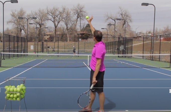 Tennis slice serve toss