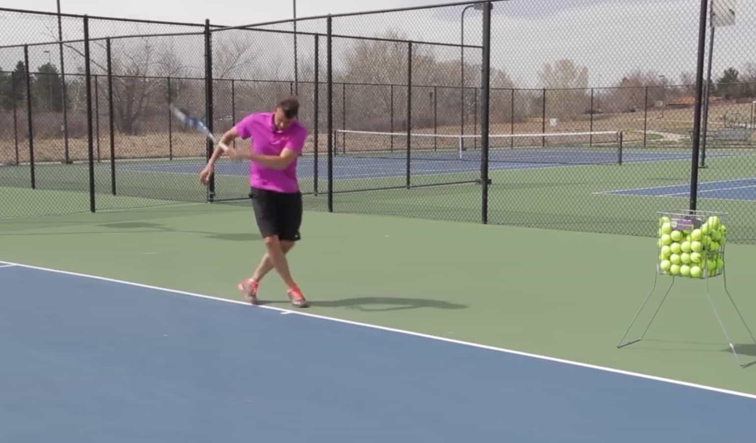 Low Tennis Forehand On The Middle Of The Court
